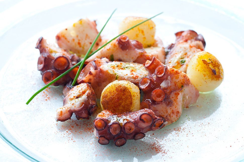 13873074 - macro close up of octopus appetizer with small potatoes.