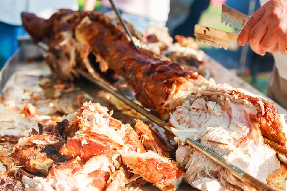 Carving the delicious pig roast